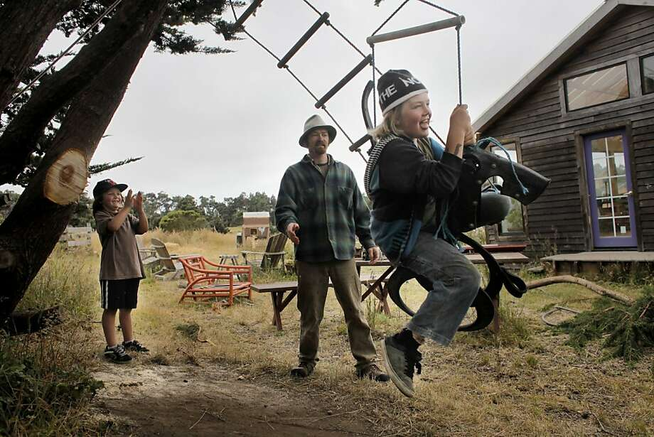 Bryce Duggan, left  claps with excitement as his father Ben pushes his brother Logan on their new tree swing outside their home on the Windy Hollow Farm, Monday June 11, 2011, in Point Arena, Calif. Photo: Lacy Atkins, The Chronicle