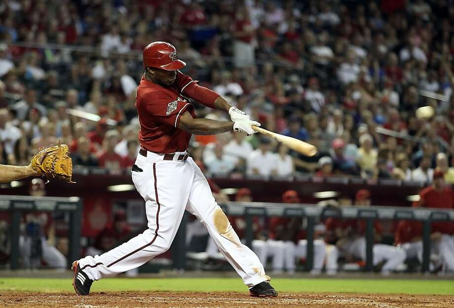 PHOENIX, AZ - JULY 24:  Justin Upton #10 of the Arizona Diamondbacks hits a two RBI double against the Colorado Rockies during the third inning of the Major League Baseball game at Chase Field on July 24, 2011 in Phoenix, Arizona. Photo: Christian Petersen, Getty Images
