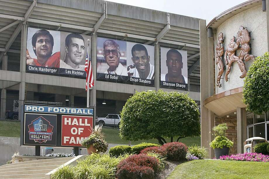 Banners featuring the Class of 2011 hang outside of Fawcett Stadium adjacent to the football museum at the Pro Football Hall of Fame, Friday, July 22, 2011, in Canton, Ohio. Although the NFL announced Thursday, July 21, the cancellation of the annual Hall of Fame Game between the Chicago Bears and the St. Louis Rams, the enshrinement will go ahead as planned. Deion Sanders, Chris Hanburger, Les Richter, Ed Sabol, Shannon Sharpe, Richard Dent, and Marshall Faulk represent the Class of 2011 who will be enshrined on Aug. 6, 2011. (AP Photo/The Repository, Scott Heckel) MANDATORY CREDIT Photo: Scott Heckel, AP