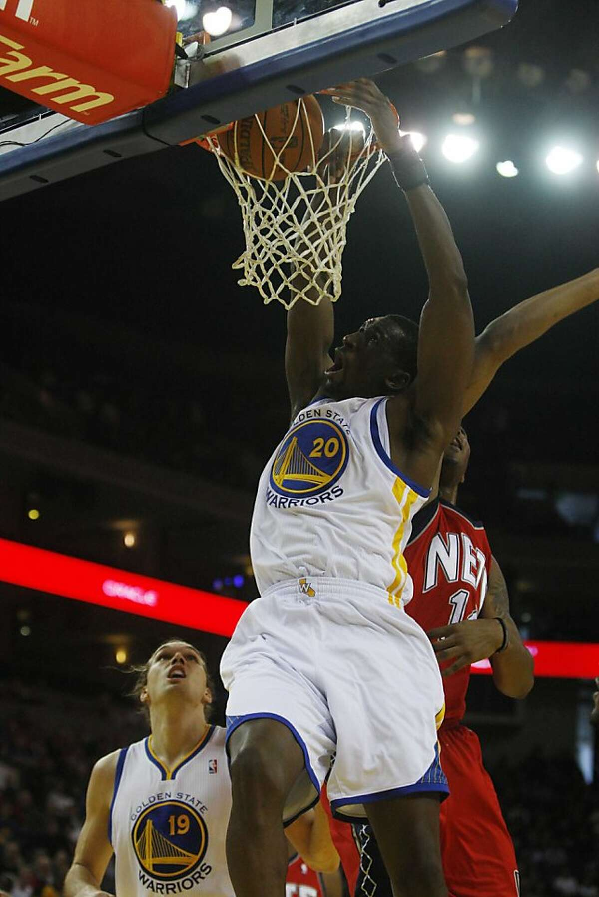 Warriors #20 Ekpe Udoh dunks one in the basket at Oracle Arena during the first half of a home game with Golden State Warriors and the New Jersey Nets on Monday January. 17, 2011 in Oakland, Calif. Ran on: 01-22-2011 The Warriors win-now philosophy has limited Ekpe Udohs playing time. Ran on: 07-25-2011 Warriors forward Ekpe Udoh is working on two things at Baylor: his degree and staying in shape.