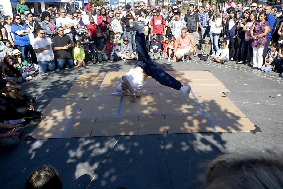 People gather around on Fishermen's Wharf on Sunday, July 24, 2011 to watch B.Boy Pedro break dance. Photo: Michelle Terris, The Chronicle