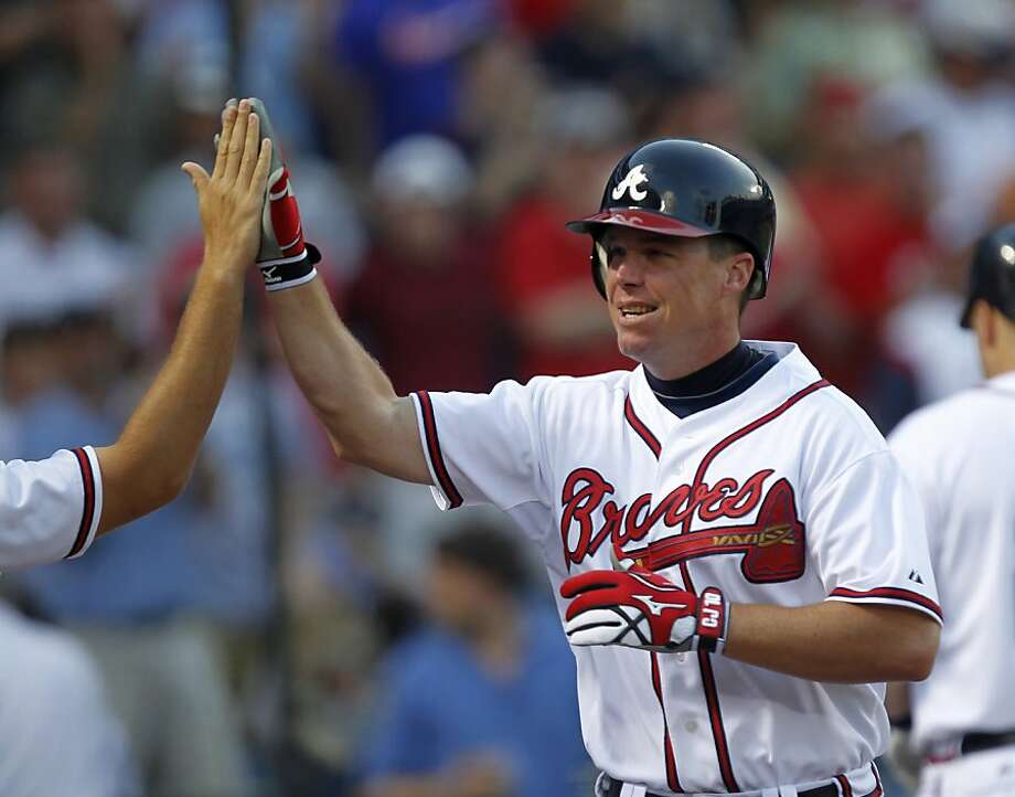 Atlanta Braves' Chipper Jones celebrates after hitting a two-run home run during the third inning of a baseball game against the Colorado Rockies, Wednesday, July 6, 2011, in Atlanta. Atlanta won 9-1. Photo: =Name=, AP