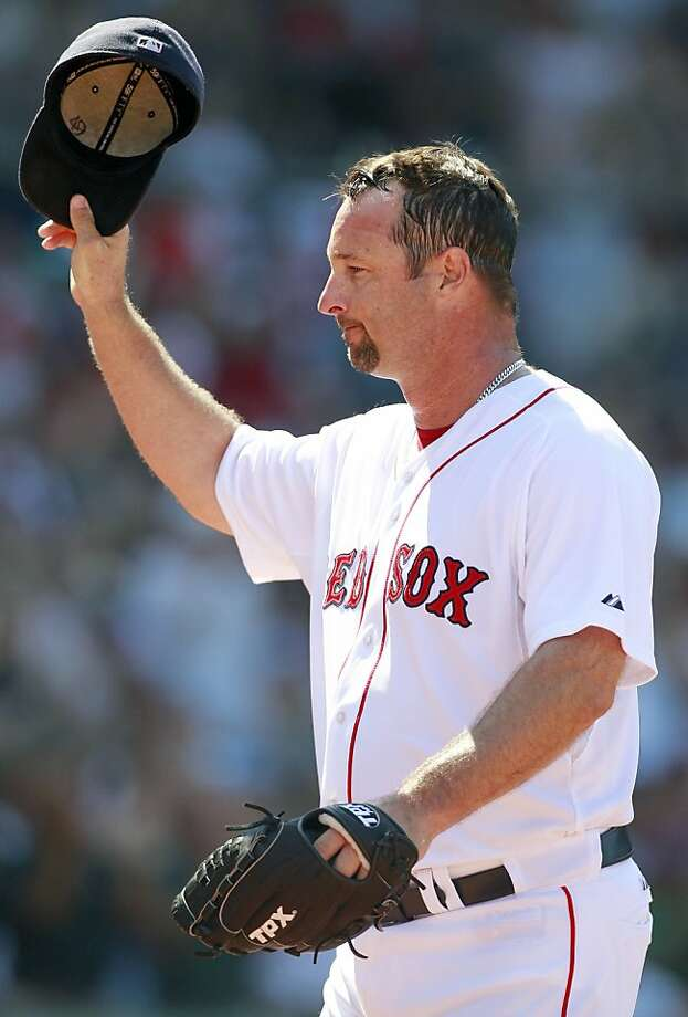 Boston Red Sox's Tim Wakefield tips his cap as he comes off the field in the sixth inning of a baseball game against the Seattle Mariners in Boston, Sunday, July 24, 2011. Wakefield joined Roger Clemens as the only pitchers to strike out 2,000 batters with Boston and moved one win away from his 200th victory. The Red Sox won 12-8. Photo: Michael Dwyer, AP