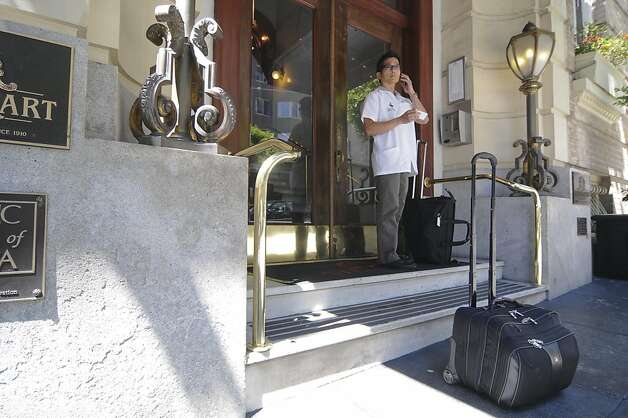 Veterinarian Dr. Calvin Lum arrives at the Steinhart Hotel and Apartments to make a housecall on Tuesday, July 19. He is performing a first exam for Marcus Ross's recently rescued boxer, Miles. Miles was adopted by Ross on Sunday, July 17, while he was in the city working on Billy Elliot (Ross normally lives in Las Vegas). Dr. Lum has also done housecalls for Ross's other boxer, Carly, who was adopted in 2007. Dr. Lum runs his practice, San Francisco Veterinarian Housecalls, out of his childhood home in San Francisco. Photo: Skyler Reid, Special To The Chronicle