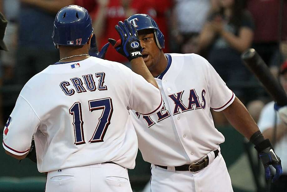 ARLINGTON, TX - JULY 22:  Nelson Cruz #17 of the Texas Rangers celebrates a three-run home run with Adrian Beltre #29 against the Toronto Blue Jays at Rangers Ballpark in Arlington on July 22, 2011 in Arlington, Texas. Photo: Ronald Martinez, Getty Images