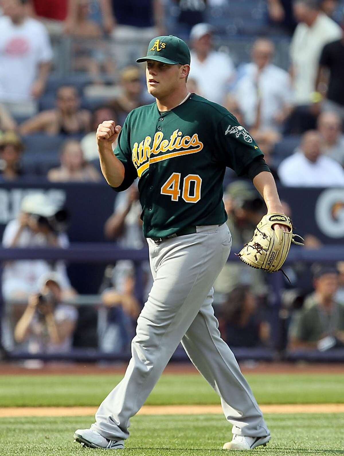 Andrew Bailey #40 of the Oakland Athletics celebrates after defeating the New York Yankees on July 23, 2011 at Yankee Stadium in the Bronx borough of New York City.