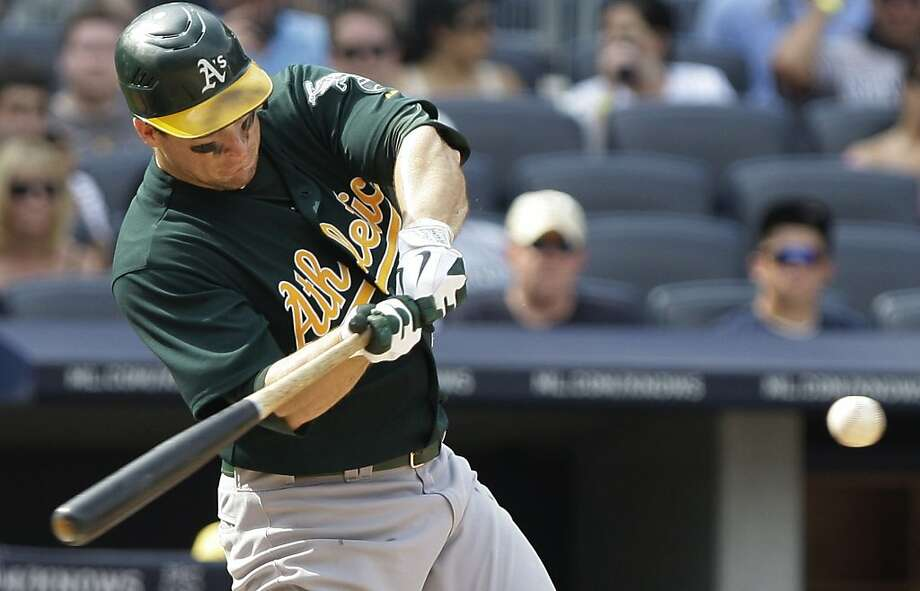 Oakland Athletics' Josh Willingham hits a single during the ninth inning of a baseball game against the New York Yankees Saturday, July 23, 2011, at Yankee Stadium in New York. The Athletics won the game 4-3. Photo: Frank Franklin II, AP