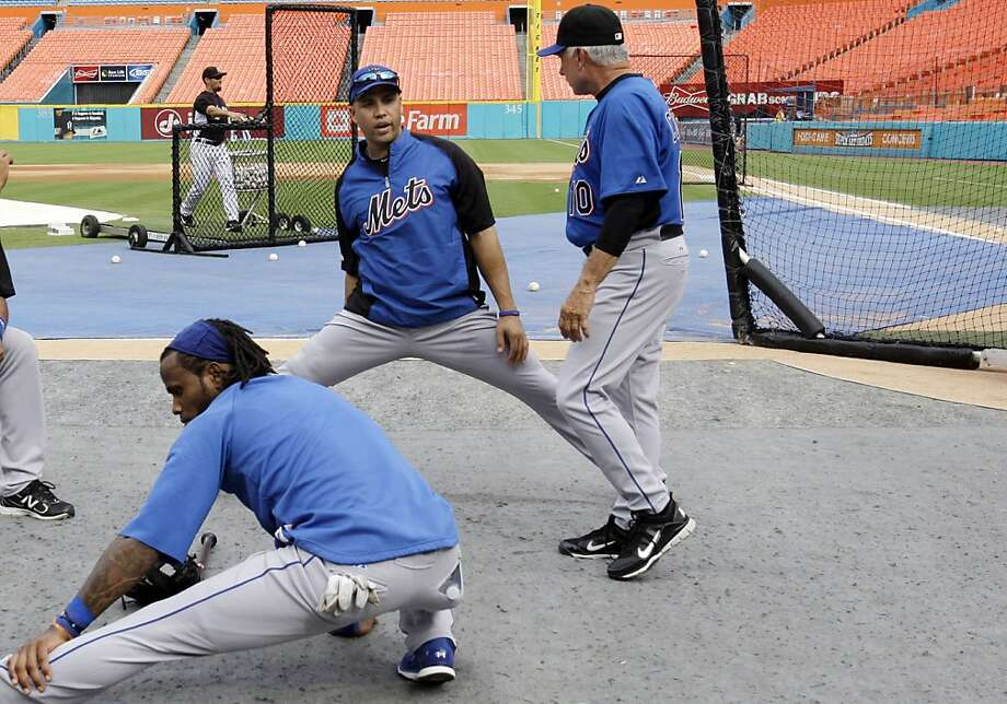 New York Mets right fielder Carlos Beltran, center, talks with manager Terry Collins, right, before a baseball game against the Florida Marlins in Miami, Friday, July 22, 2011. Shortstop Jose Reyes stretches in the foreground. Photo: Lynne Sladky, AP