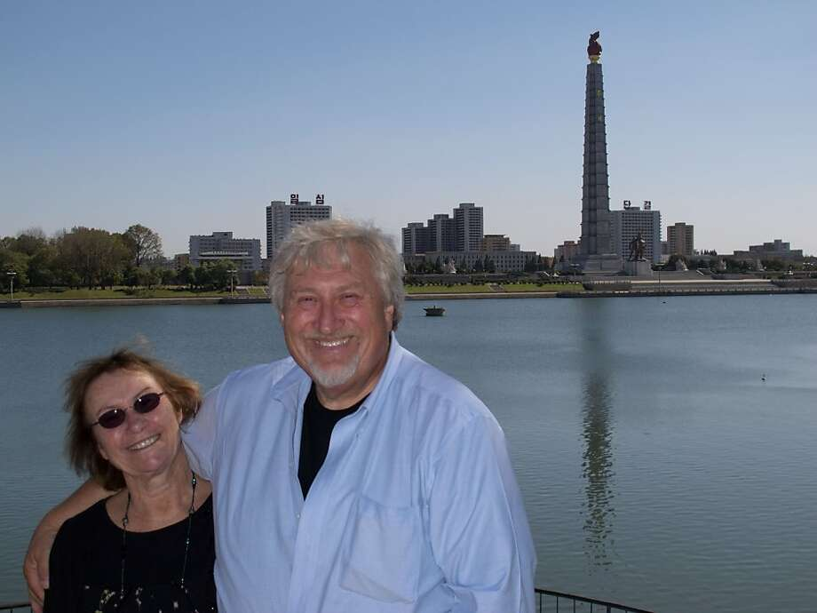 Tom and Lilka Areton in front of the Juche Tower, Pyongyang, North Korea Photo: Tom Areton