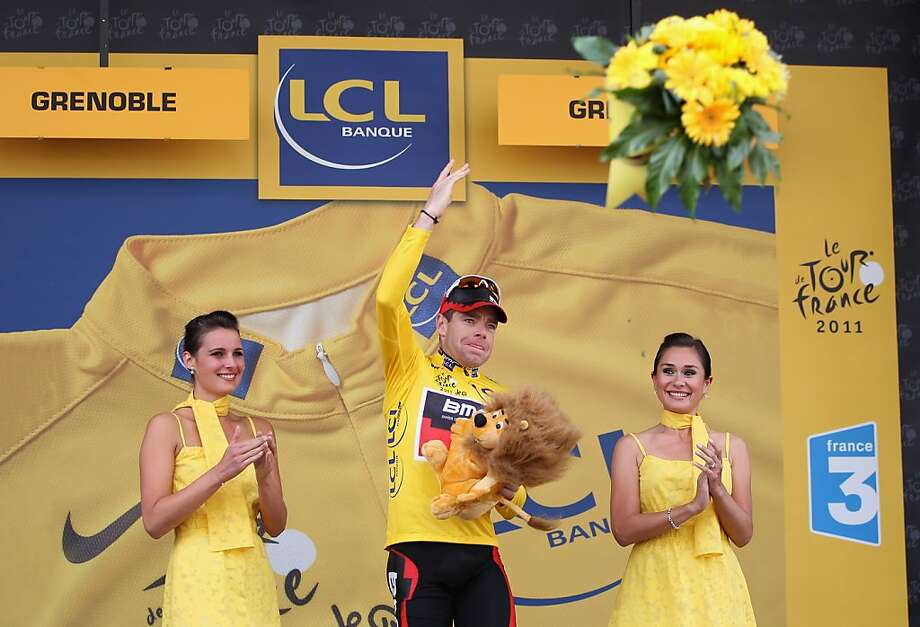GRENOBLE, FRANCE - JULY 23:  Cadel Evans of Australia and BMC Racing Team throws a bouquet of flowers into the crowd after becoming the race leaders yellow jersey after the Individual Time Trial Stage 20 of the 2011 Tour de France on July 23, 2011 in Grenoble, France. Photo: Michael Steele, Getty Images