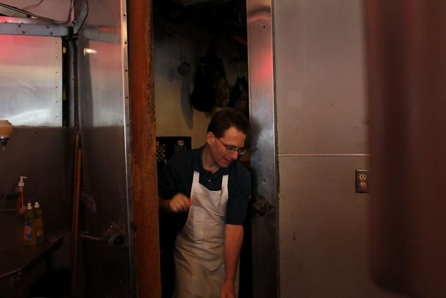 Mike Spinali, 44, who first started working at the Little City Market as a summer job at the age of 15, walks out of the meat locker inside the store. Photo: Mike Kepka, The Chronicle