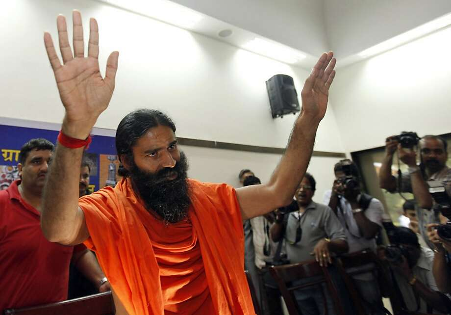 Indian Yoga Guru Baba Ramdev gestures as he arrives to address a press conference in New Delhi, India, Sunday, June 26, 2011. Early this month, a fasting Ramdev and thousands of his followers who were protesting against corruption were forced from a New Delhi park in a police raid that injured dozens and sparked even more public outrage. Photo: Mustafa Quraishi, AP