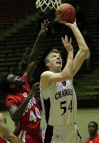 Churchill's Connor Lammert (54) shoots against Judson's Derrik Luster (40) in boys basketball at Littleton Gym on Tuesday, Dec. 6, 2011. The Chargers defeated the Rockets, 52-44. Photo: KIN MAN HUI, ~ / SAN ANTONIO EXPRESS-NEWS
