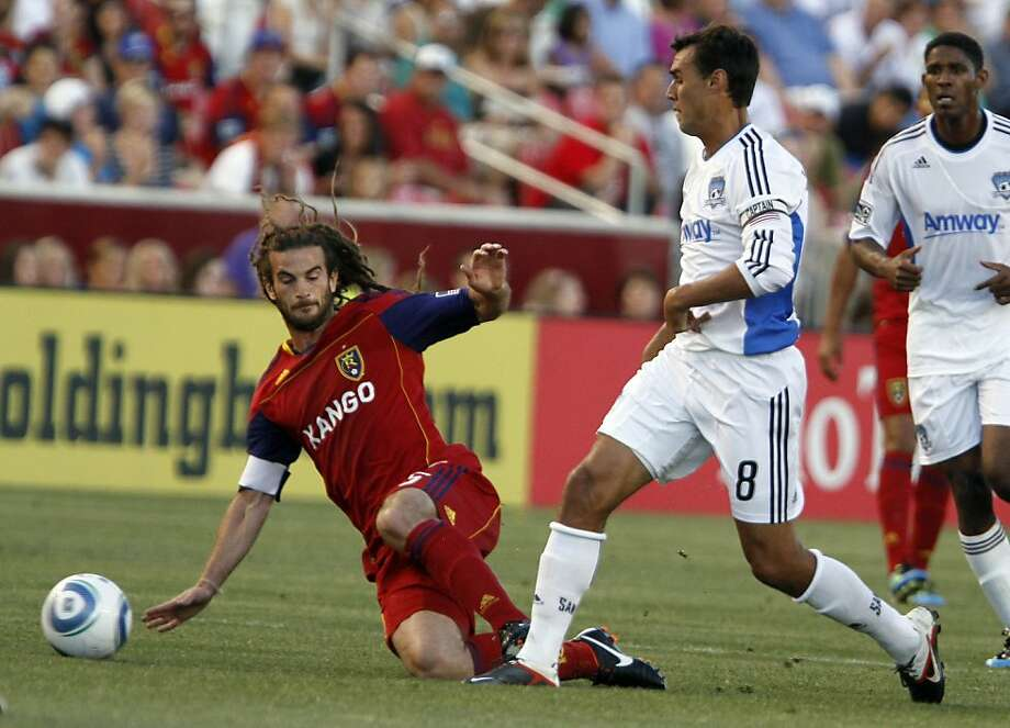 Real Salt Lake midfielder Kyle Beckerman (5) slide tackles San Jose Earthquakes forward Chris Wondolowski (8) during the first half of their MLS soccer match in Salt Lake City, Utah, Saturday, July 23, 2011. Photo: Jim Urquhart, AP