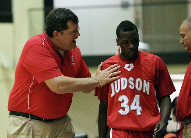Judson coach Mike Wacker (left) talks with his player Sheawn Bedford (34) after a play violation during their game against Churchill at Littleton Gym on Tuesday, Dec. 6, 2011. The Chargers defeated the Rockets, 52-44. Photo: KIN MAN HUI, ~ / SAN ANTONIO EXPRESS-NEWS