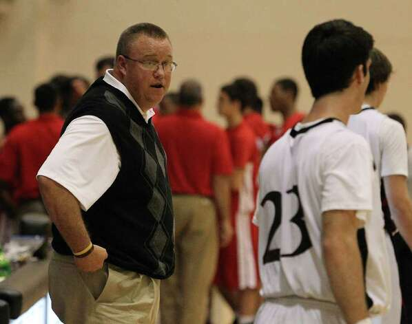 Churchill coach Timothy Woods (left) gives his players last moment instructions at the end of a timeout during their game against Judson at Littleton Gym on Tuesday, Dec. 6, 2011. The Chargers defeated the Rockets, 52-44. Photo: KIN MAN HUI, ~ / SAN ANTONIO EXPRESS-NEWS
