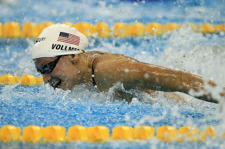 SHANGHAI, CHINA - JULY 24: Dana Vollmer of United States competes in the Women's 100m Butterfly heats during Day Nine of the 14th FINA World Championships at the Oriental Sports Center on July 24, 2011 in Shanghai, China. Photo: Ezra Shaw, Getty Images