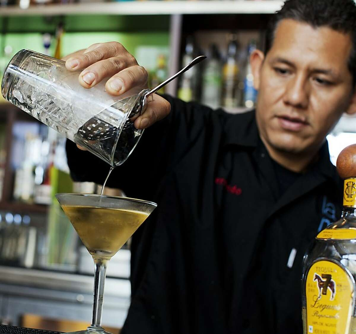 Bartender Fernado Maza pours an El Chalan cocktail at La Mar Cebicheria Peruana.