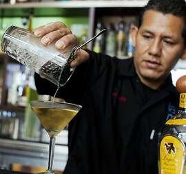 Bartender Fernado Maza pours an El Chalan cocktail at La Mar Cebicheria Peruana.