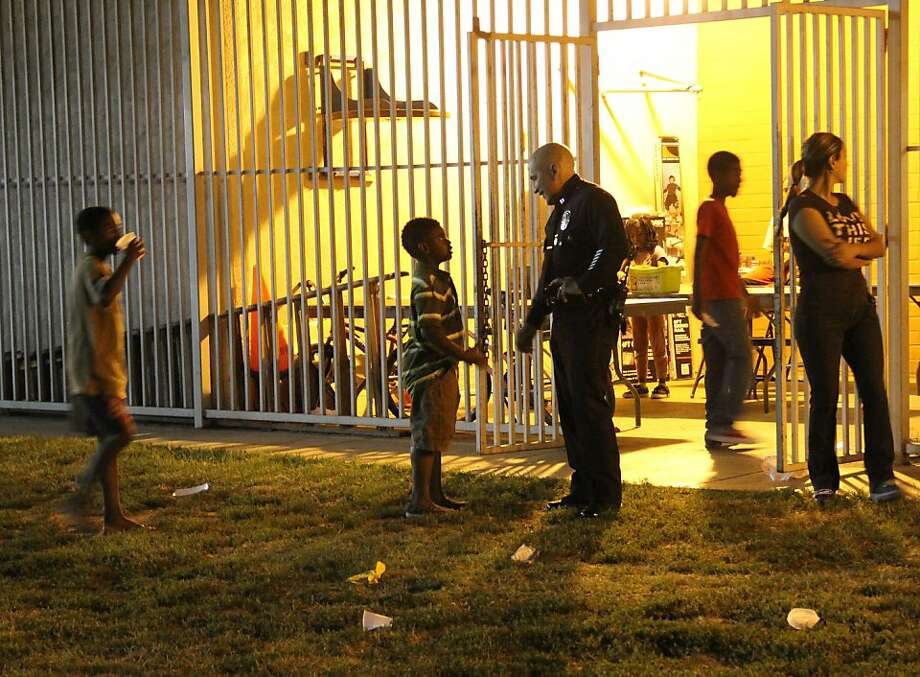 In this Wed. July 6, 2011, Capt. Raymond Maltez of the Los Angeles Police Department's southeast division speaks to residents at the Algin Sutton Recreation Center in South Los Angeles. The center is being included in the city's Summer Night Lights program to reduce gang violence for the first time this year. Photo: Thomas Watkins, AP
