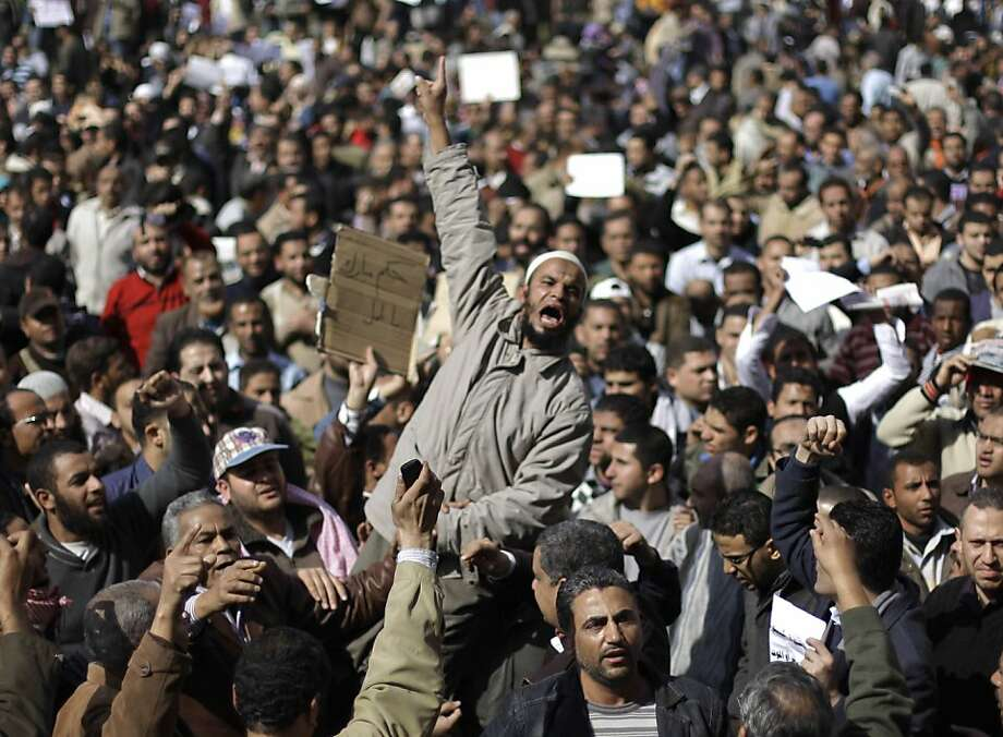 People demonstrate in Cairo, Egypt, Monday, Jan. 31, 2011. A coalition of opposition groups called for a million people to take to Cairo's streets Tuesday to ratchet up pressure for President Hosni Mubarak to leave. Photo: Ben Curtis, AP