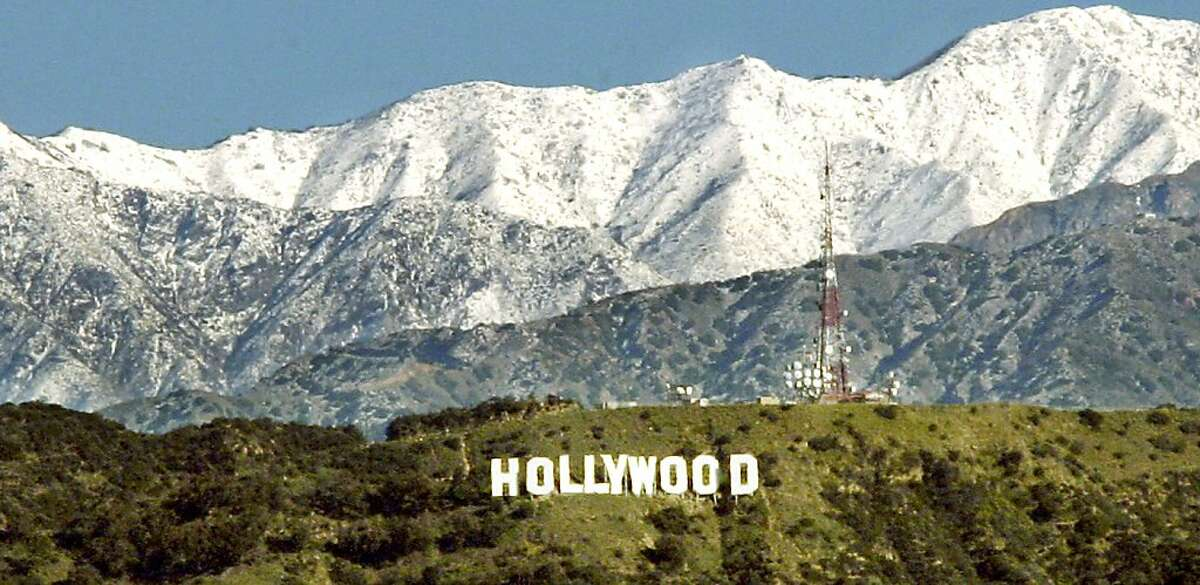 The Hollywood Sign has a backdrop of the snow-covered peaks of the San Gabriel Mountains in the Los Angeles basin, following days of rain, snow and abnormally cold temperatures, Sunday, Feb. 27, 2011. Temperatures dipped into 30s and caused weather officials to issue a frost advisory for the San Fernando and San Gabriel valleys.