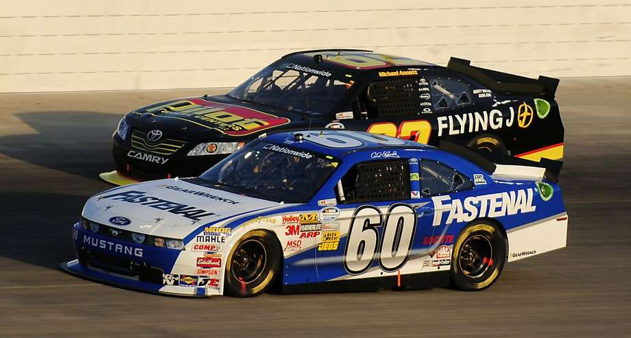 Carl Edwards (60) leads Michael Annett through a turn during the Federated Auto Parts 300 NASCAR Nationwide Series auto race on Saturday, July 23, 2011, in Gladeville, Tenn. Photo: Mike Strasinger, AP