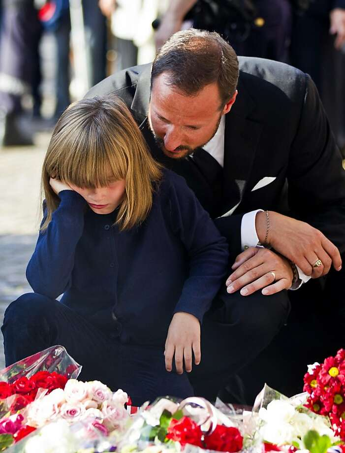 Norwegian Crown Prince Haakon, right, and Princess Ingrid Alexandra attend a vigil for victims of Friday's attacks in Oslo and Utoya island, outside Oslo Cathedral, Saturday, July 23, 2011. A massive bombing Friday in the heart of Oslo was followed by a horrific shooting spree on an island hosting a youth retreat for the prime minister's center-left party. The same man, a Norwegian with reported Christian fundamentalist, anti-Muslim views, was suspected in both attacks. (AP Photo/Scanpix Norway, Vegard Groett) NORWAY OUT Photo: Vegard Groett, AP