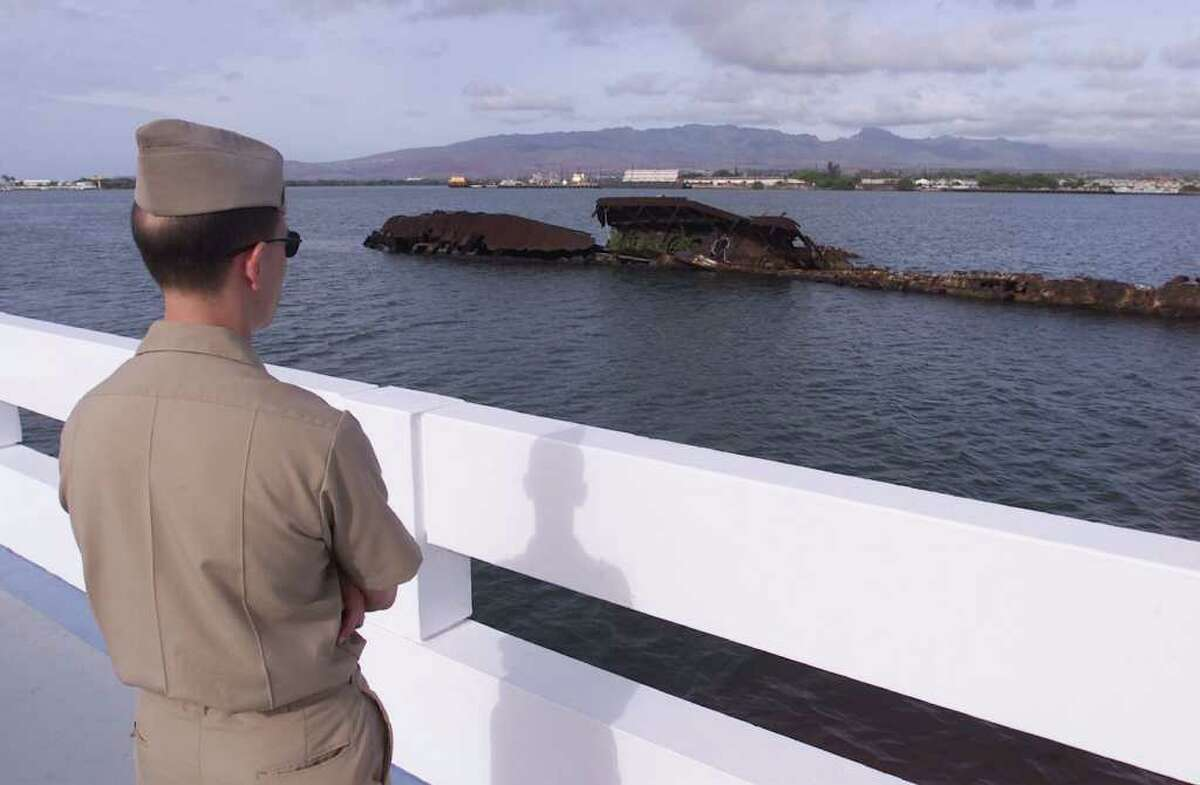 ADVANCE FOR SUNDAY, NOV. 25--Chief Jerry Sekerek, a Navy spokesman, looks at the rusting hulk of the USS Utah from the Utah Memorial on Ford Island at Pearl Harbor, Hawaii Nov 9, 2001. The little-know memorial honors 54 sailors entombed in the ship that sank during the attack 60 years ago on Pearl Harbor. (AP Photo/Ronen Zilberman)