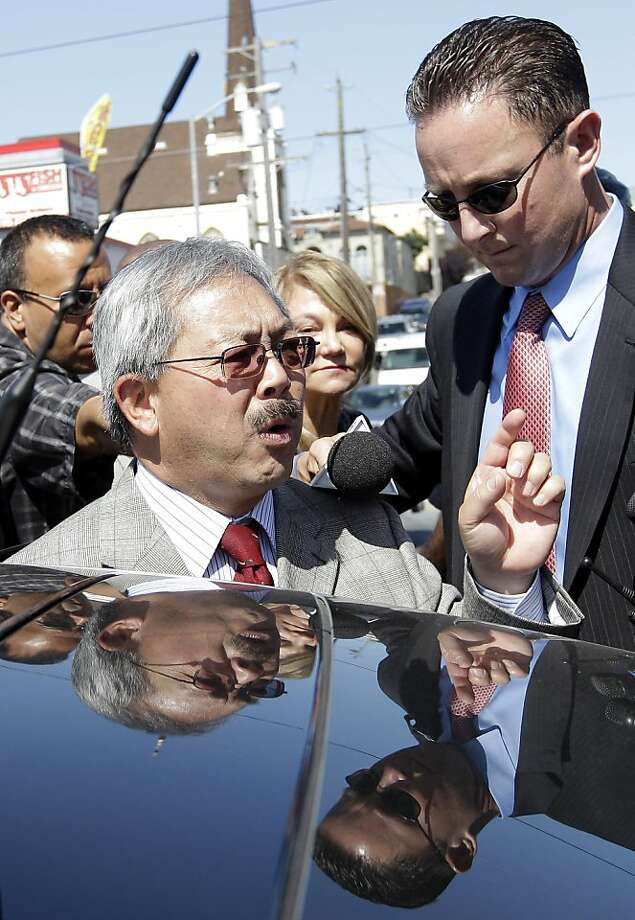San Francisco mayor Ed Lee, left, speaks with reporters before entering his car after a library groundbreaking ceremony in San Francisco, Friday, July 22, 2011. Photo: Jeff Chiu, Associated Press