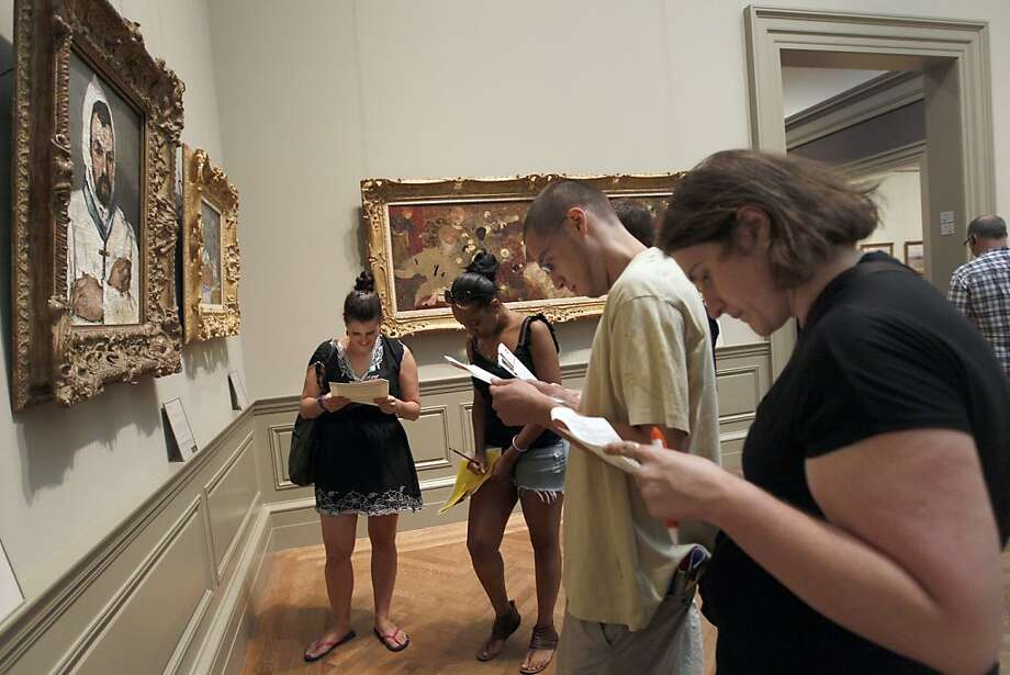 "In this July 9, 2011 photo, Noga Pnueli, left, Rayna White, second from left, Jeffrey Martinez, second from right, and Dana Zolli look for clues in one of the galleries at the Metropolitan Museum of Art during a Watson Adventures ""Murder at the Met"" scavenger hunt, in New York. Photo: Mary Altaffer, AP"
