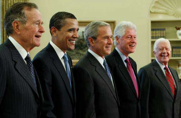 President George W. Bush, center, poses with President-elect Barack Obama, and former presidents, from left, George H.W. Bush, left, Bill Clinton and Jimmy Carter, right, Wednesday, Jan. 7, 2009, in the Oval Office of the White House in Washington. (AP Photo/J. Scott Applewhite) Photo: J. Scott Applewhite, ASSOCIATED PRESS / AP2009