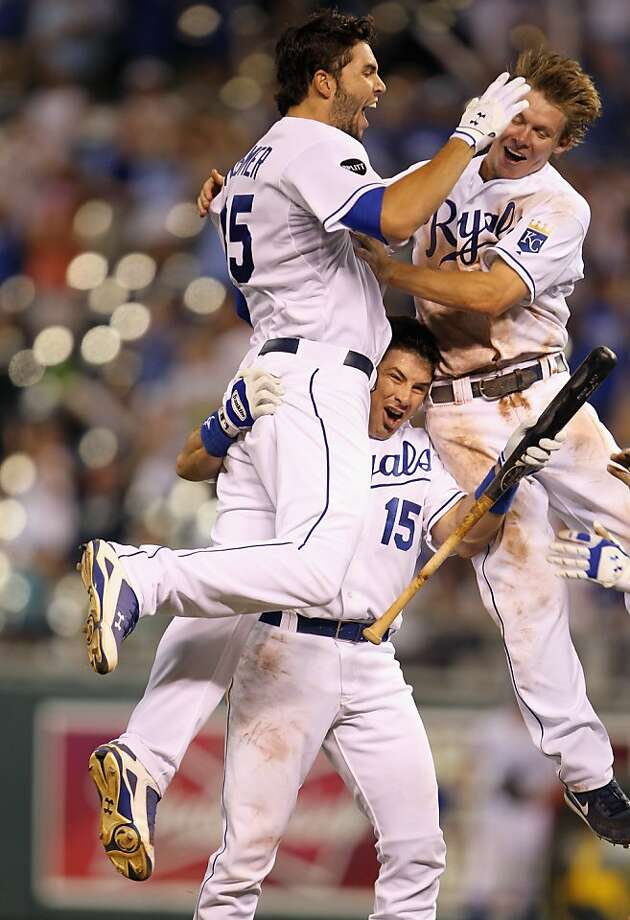 KANSAS CITY, MO - JULY 23:  Eric Hosmer #35, Matt Treanor #15 and Chris Getz #17 of the Kansas City Royals celebrate after Hosmer knocked in the game-winning run during the bottom of the 10th inning of the game on July 23, 2011 at Kauffman Stadium in Kansas City, Missouri.  The Royals defeated the Rays with a final score of 5-4. Photo: Jamie Squire, Getty Images