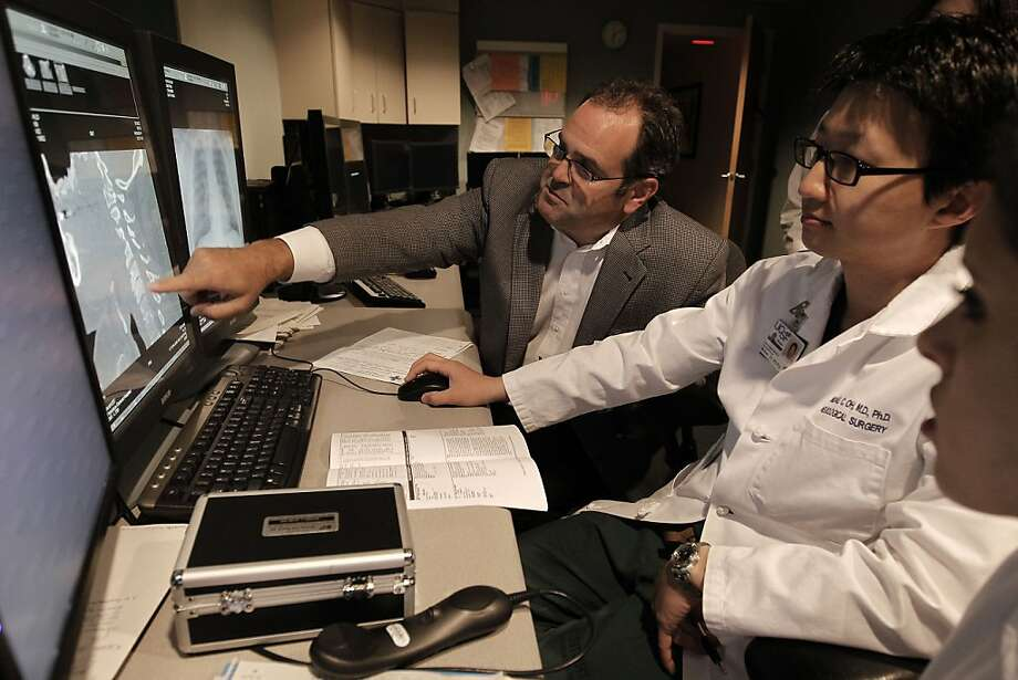 The Chief of Neurosugery, Dr. Geoff Manley, (left) meets with chief resident MIchael Oh and Dr. Emily Anton as they go over the patients information from the night before at San Francisco General Hospital,  in San Francisco, on Friday June 29, 2011. Dr. Manley is currently taken care of San Francisco Giants fan, Bryan Stow, who was badly beaten on opening night of the baseball season in Los Angeles and remains in a coma  3 1/2 months later. Photo: Michael Macor, The Chronicle