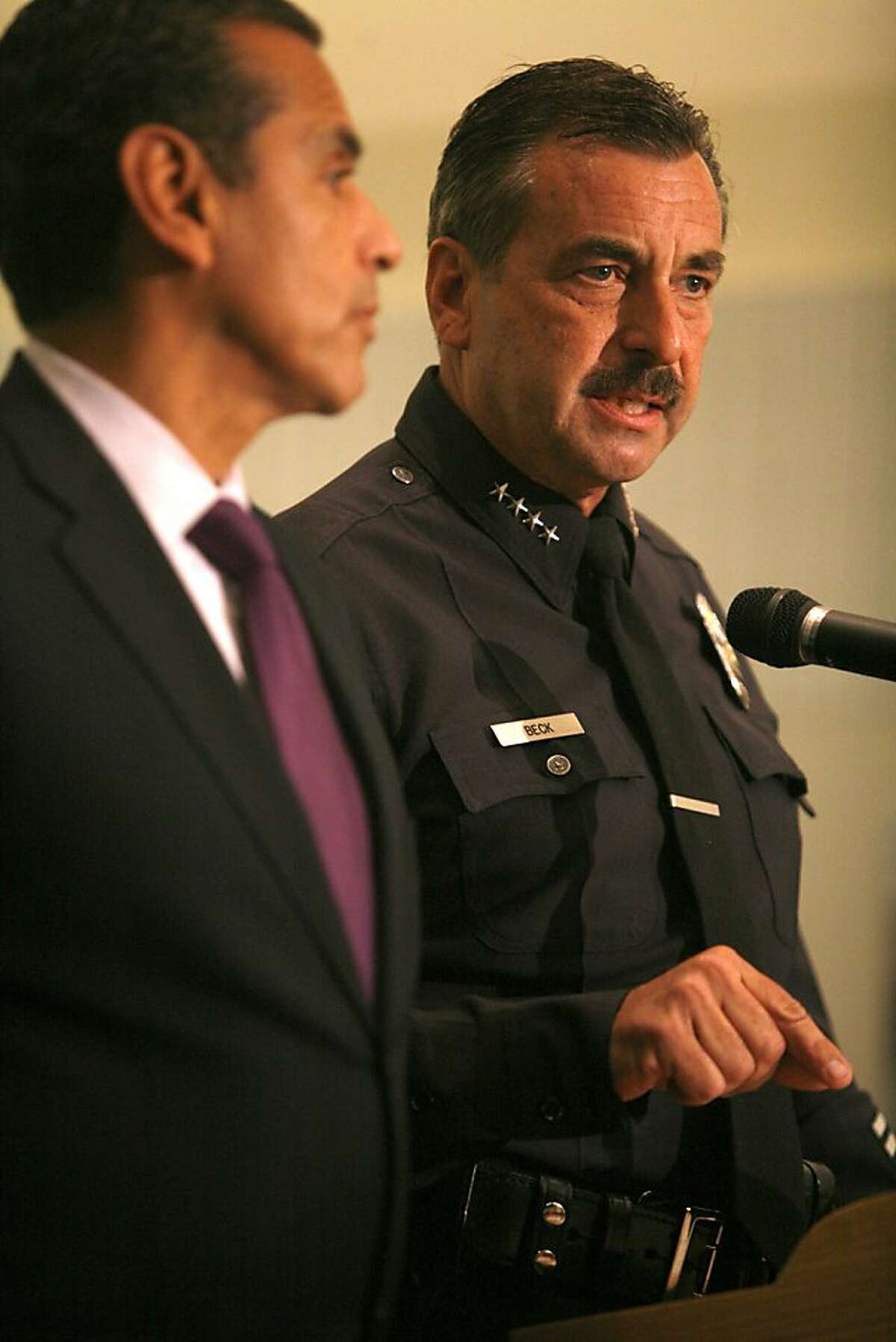 Flanked by Los Angeles, California, Mayor Antonio Villaraigosa, Los Angeles Police Department Chief Charlie Beck talks to the media after three new suspects were arrested on Friday, July 22, 2011, in connection with the Dodger Stadium beating of San Francisco Giants fan Bryan Stow.