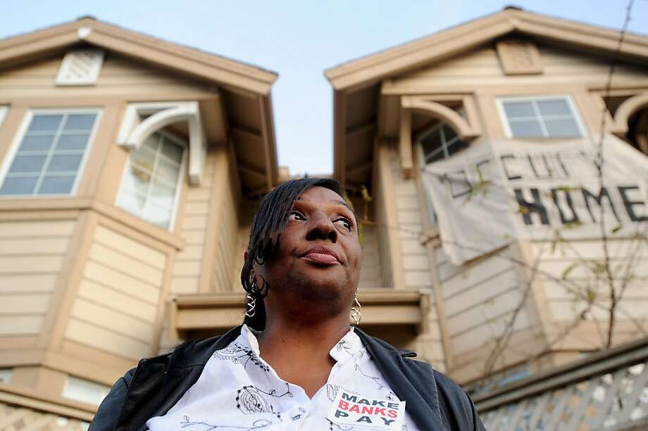Standing outside her foreclosed Adeline St. home, Gayla Newsome joins about a hundred Occupy Oakland protesters rallying against home foreclosures on Tuesday, Dec. 6, 2011, in Oakland, Calif. Newsome said supporters reoccupied her home earlier in the day, four months after sheriff's evicted her family in July. Photo: Noah Berger, Special To The Chronicle