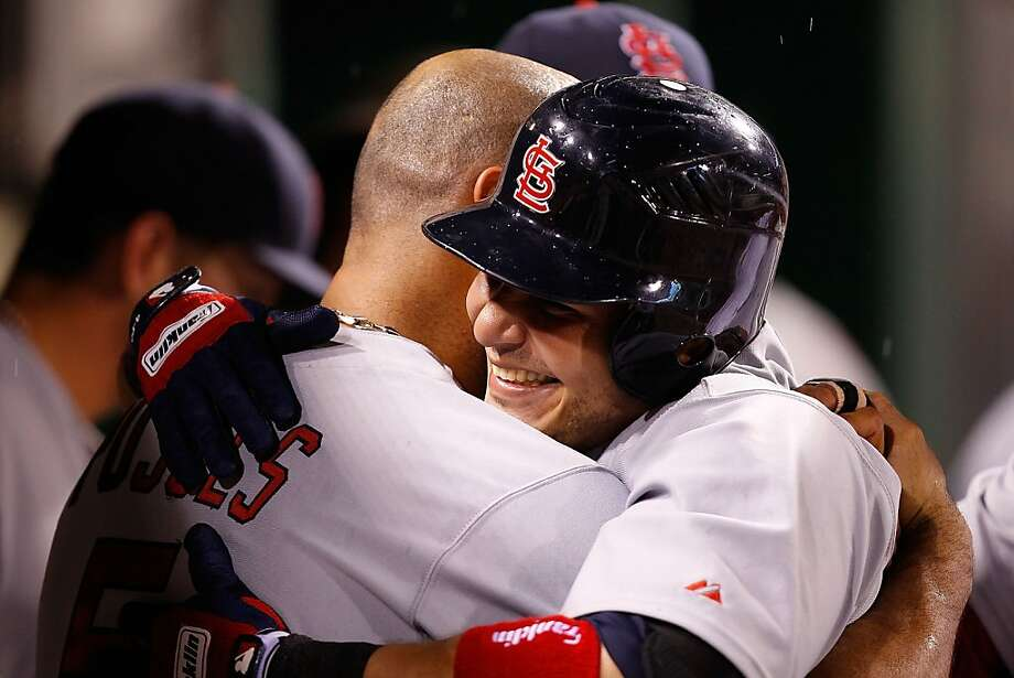 PITTSBURGH - JULY 22:  Yadier Molina #4  of the St Louis Cardinals is congratulated by Albert Pujols #5 in the dugout after hitting a solo home run against the Pittsburgh Pirates during the game on July 22, 2011 at PNC Park in Pittsburgh, Pennsylvania. Photo: Jared Wickerham, Getty Images
