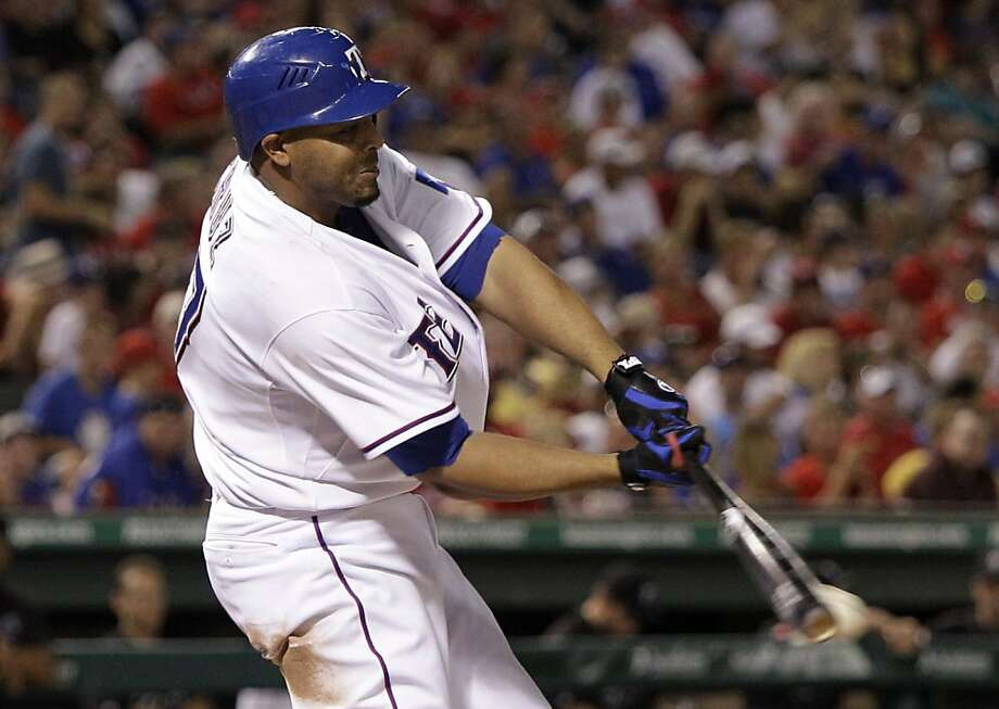 Texas Rangers' Nelson Cruz connects for an two-run single off Toronto Blue Jays reliever Shawn Camp in the sixth inning of a baseball game on Friday, July 22, 2011, in Arlington, Texas. Cruz had eight RBIs in the 12-2 Rangers win. Photo: Tony Gutierrez, AP