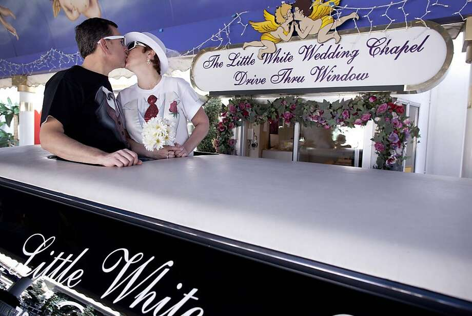 Richard, left, and Lisa Dishong, of Harrisburg, Penn. kiss while waiting to be married at the drive thru window of the Little White Wedding Chapel, Monday, Feb. 14, 2011 in Las Vegas. Fewer than 92,000 couples married in or around Sin City last year. Thelast time the city of drive-through wedding chapels married fewer people, it was 1993. The wedding industry hopes Valentine's Day provides some much needed sizzle, but they aren't betting on it. Photo: Julie Jacobson, AP