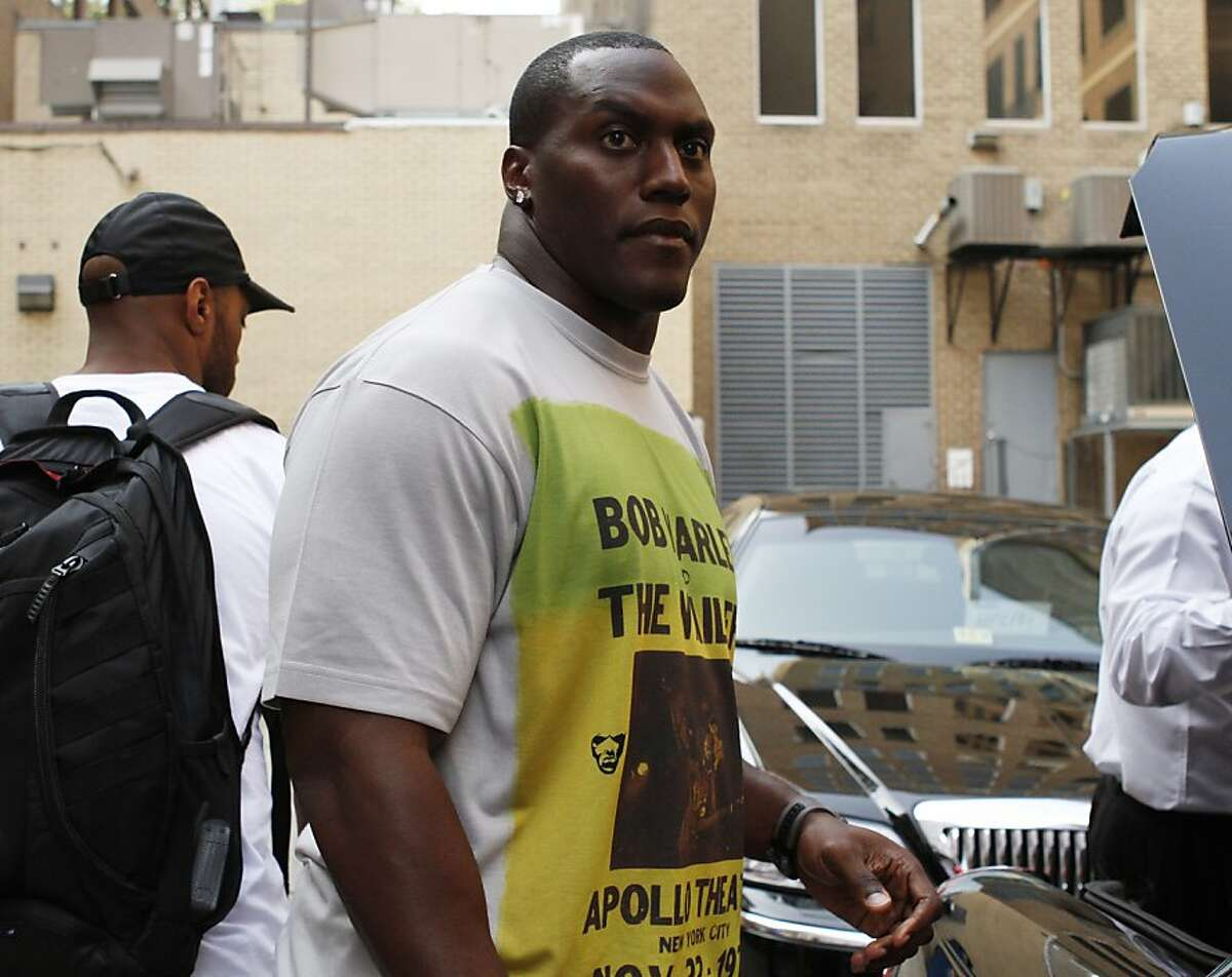 Takeo Spikes of the San Francisco 49ers leaves the NFL Players Association, Wednesday, July 20, 2011, in Washington, as talks to end the NFL lockout continued.