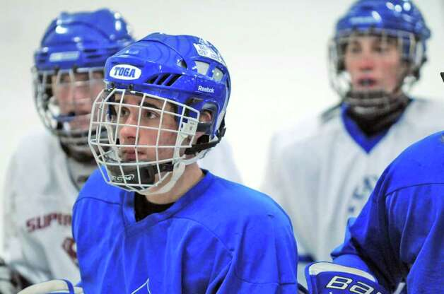 Saratoga Springs High School hockey player Alex Luse, second from left,  listens during practice on Tuesday Dec. 6, 2011 in Saratoga Springs, NY.  (Philip Kamrass / Times Union ) Photo: Philip Kamrass / 00015660A