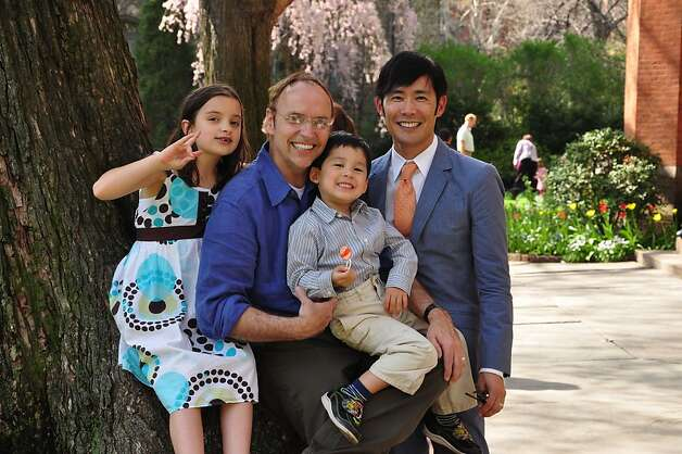 Dr. Kevin Mack, second from left, with his husband, Naoki Nitta, and daughter Chiaki Nitta-Mack (left) and son Nobu Nitta-Mack. Mack was killed July 14, 2011, in the crash of a UCSF shuttle bus. Photo: Family Photo