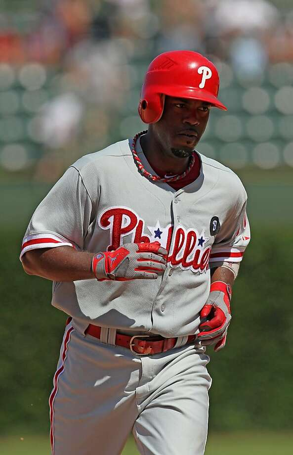CHICAGO, IL - JULY 20: Jimmy Rollins #11 of the Philadelphia Phillies runs the bases after hitting the first of two home run against the Chicago Cubs at Wrigley Field on July 20, 2011 in Chicago, Illlinois. The Phillies defeated the Cubs 9-1. Photo: Jonathan Daniel, Getty Images