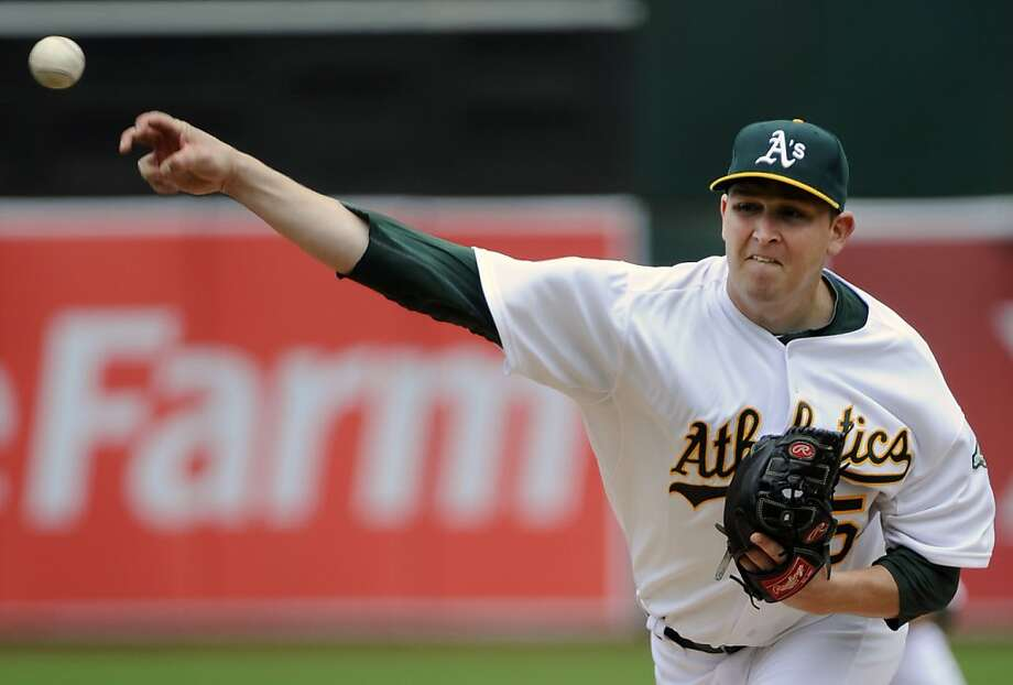 OAKLAND, CA - JULY 16: Trevor Cahill #53 of the Oakland Athletics pitches against the Los Angeles Angels of Anaheim in the first inning during an MLB baseball game at the O. co Coliseum July 16, 2011 in Oakland, California. Photo: Thearon W. Henderson, Getty Images