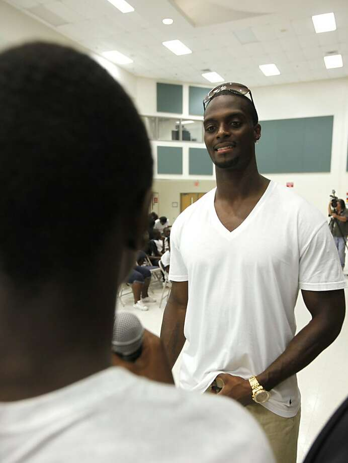 Former NFL wide receiver Plaxico Burress takes a question during his speech to children with the Urban League of Broward County, Thursday, July 21, 2011, at the Arthur Ashe Middle School in Fort Lauderdale, Fla. Released from prison last month after serving nearly two years on a gun charge, Burress has vowed to use his failings as fuel for others, pointing to himself as the illustration that everything can change in an instant. Photo: Wilfredo Lee, AP