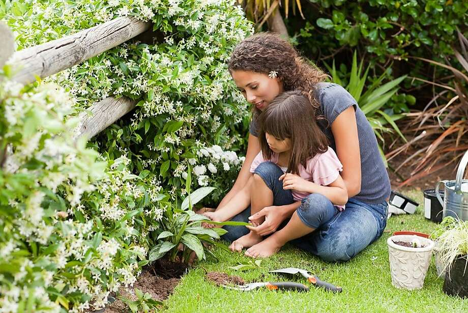 National Center for Family Literacy. A mother and daughter work in their garden -- an activity that helps them share summery learning. Photo: National Center For Family Liter