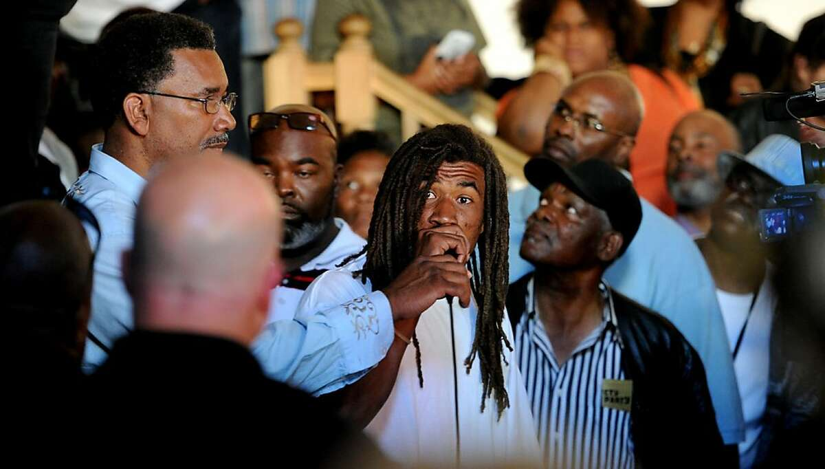 An unidentified man address San Francisco Police Chief Greg Suhr, left, during a meeting for Bayview residents upset over the police shooting of Kenneth Wade Harding on Wednesday, July 20, 2011, in San Francisco.