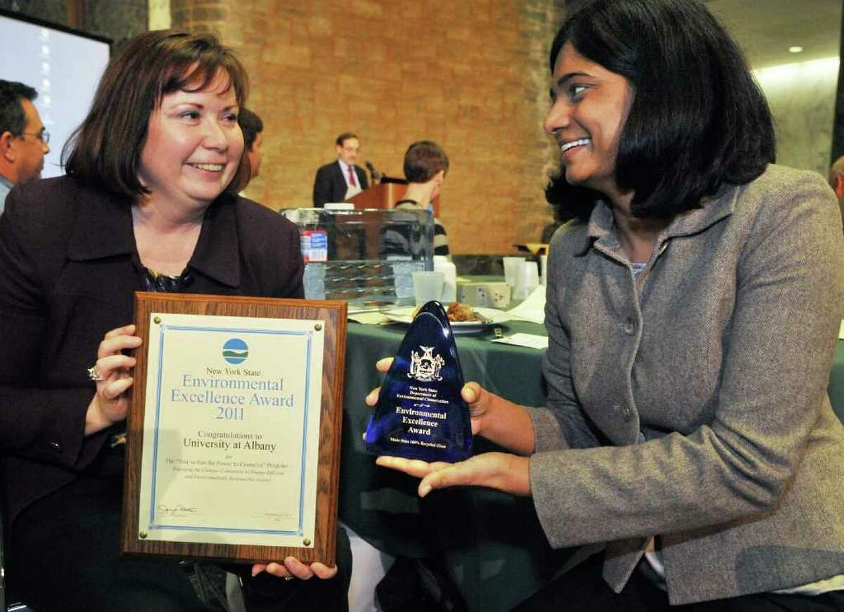 UAlbany's director of environmental sustainability, Mary Ellen Mallia, left, and energy officer Indumathi with the university's award at the New York State Department of Environmental Conservation's 8th Annual New York State Environmental Excellence Awards ceremony at the Capitol Tuesday Dec. 6, 2011. (John Carl D'Annibale / Times Union)