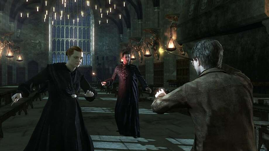 Harry Potter confronts Alecto and Amycus Carrow in an expanded scene in the video game version of Harry Potter and the Deathly Hallows Part 2. Photo: Electronic Arts