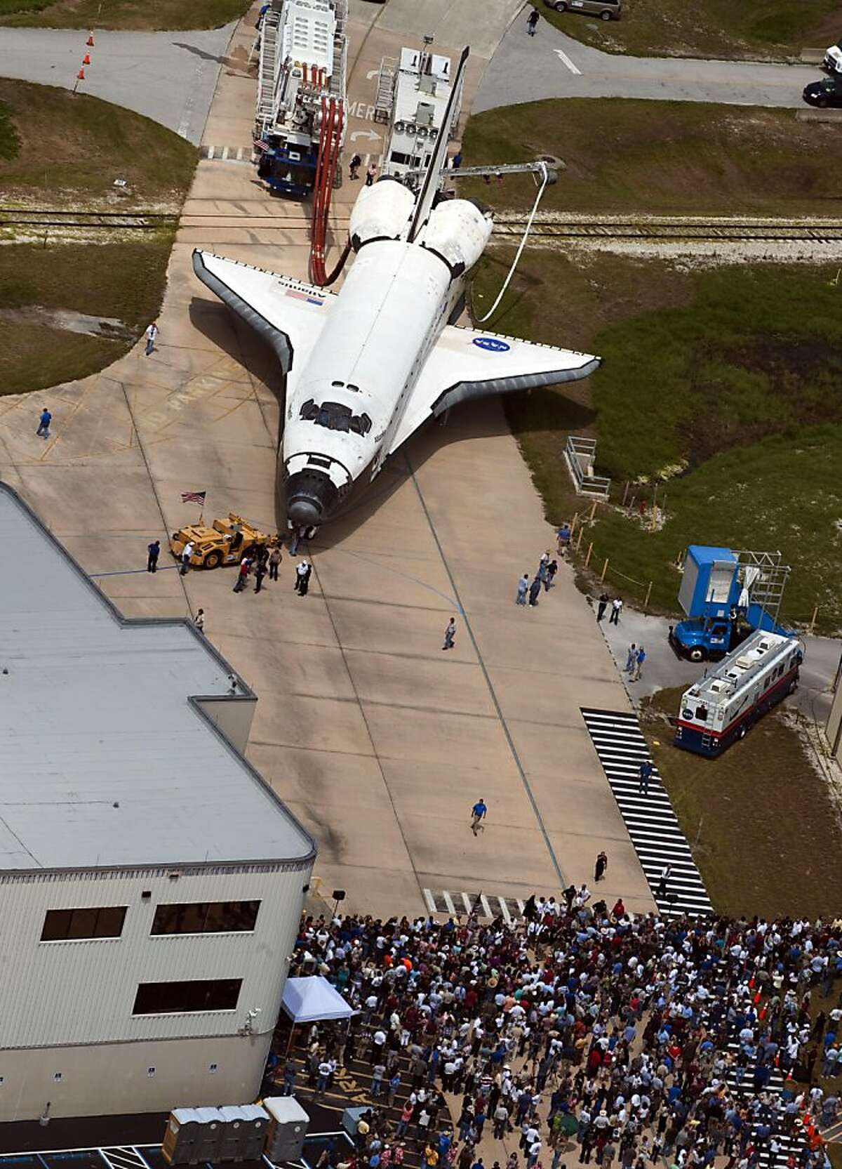 The space shuttle Atlantis is towed back to its hanger on July 21, 2011 at Kennedy Space Center in Florida, after its 13-day mission. Atlantis safely touched down bringing an end to the 30-year US shuttle program. TOPSHOTS/